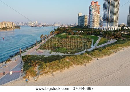 Aerial View Of South Pointe Park And South Beach In Miami Beach, Florida At Sunrise With Port Miami
