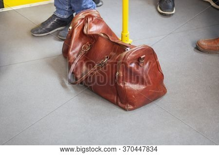 Forgotten Leather Bag In Transport. Dear Umka Left In A Crowded Place. Suspicious Subject In Public