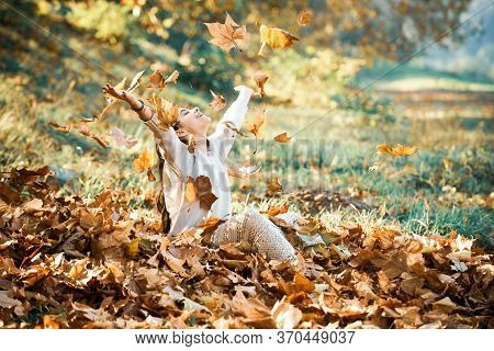 Autumn Romantic Mood. Autumn Yellow Leave In The Girls Hand. Fall Woman Portrait Of Happy Lovely And