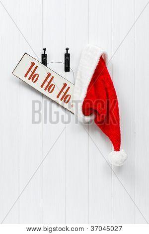 Hanging Santa Claus hat with hohoho sign