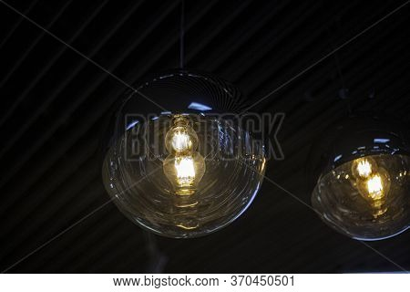 Fancy Lamps On The Ceiling. Glowing Balls. Indoor Lighting Design. Spherical Transparent Containers