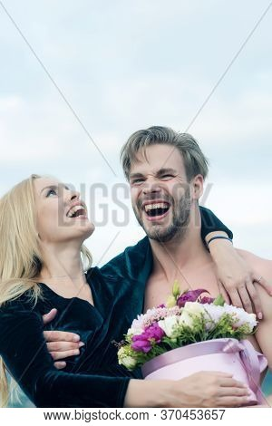 Long Live Womens Day. Couple In Love Smiling With Bouquet Of Flowers For Happe Womens Day. Happy Cou