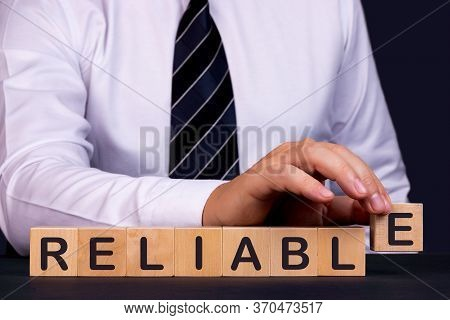 Man Made Word Reliable With Wooden Blocks. Business Concept.