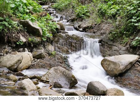 Mountain Brook Flow With Low Shutter Speed. Nature Of Carpathian Mountains In Ukraine.