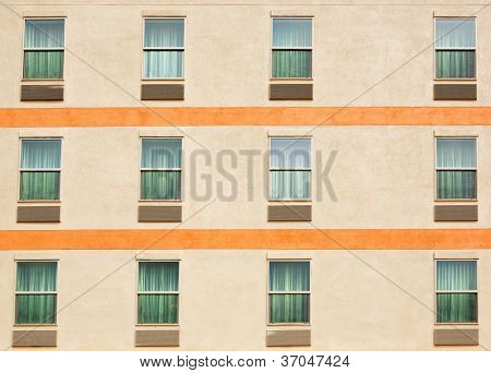 Three rows of windows on an apartment building