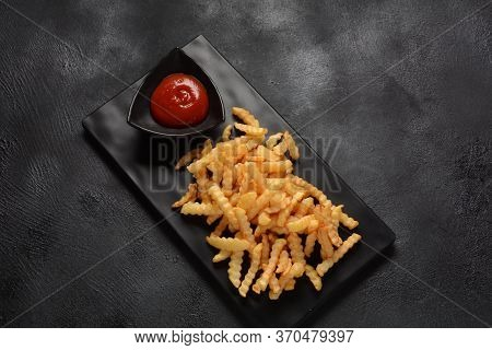 French Fries Or Potato Chips With Ketchup. Junk Food Concept