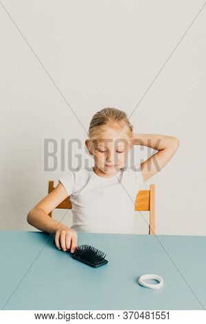 Beautiful Little Girl Blonde Combs Her Hair