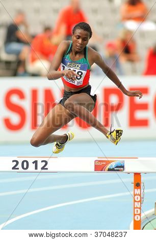 BARCELONA - JULY, 10: Daisy Jepkemei of Kenia during 3000 Metres Steeplechase event of the 20th World Junior Athletics Championships at the Olympic Stadium on July 10, 2012 in Barcelona, Spain
