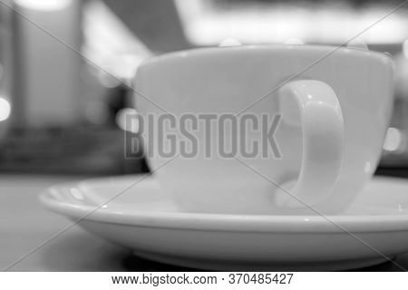 Closeup A Cup Of Coffee On Table In Monotone