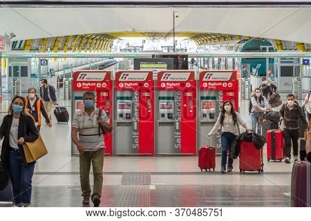 Rome, Italy - june 3, 2020: Unidentified passenger walks to departure terminal 3 in Rome Fiumicino Airport. First passengers in Rome Fiumicino Airport after Covid 19 pandemic lockdown in Italy.