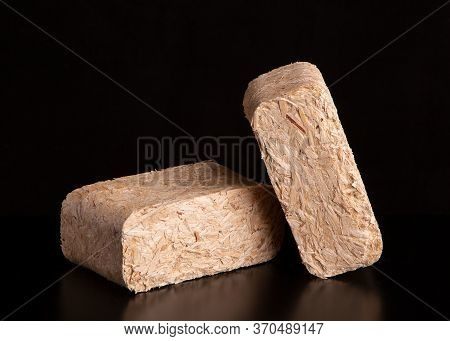 Fuel Briquettes For The Furnace. Pressed Sawdust Fuel Briquettes. Briquettes For The Oven Close-up.