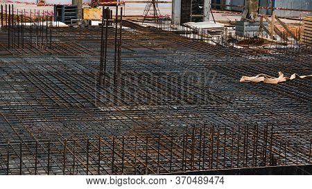 Reinforcement Of Concrete Structures. Armature On The Background Of An Industrial Workshop. Foundati