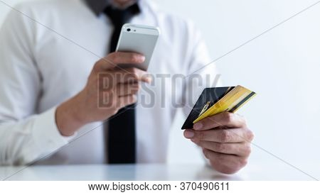 Businessman use mobile phones to register for security Online with a credit card to buy products onl