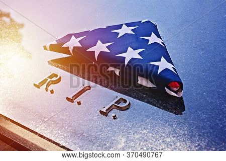 Folded Into Triangle American Flag On Memorial Marble Tomb With R.i.p. Text. Flag Folding Ceremony I