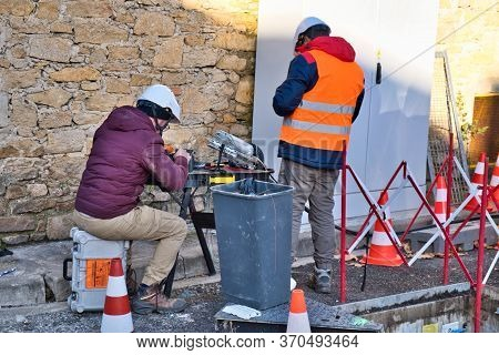 Limoux Aude France 12/10/19 Technicians Working In The Street Installing Fibre Optic Network For Hig