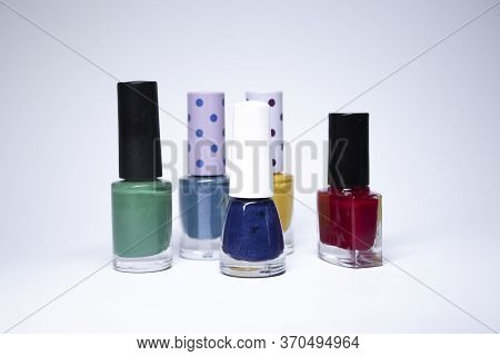 Bottles With Nail Polish On White Background. Nail Lacquer. Nail Manicure Concept. Isolated, Copy Sp