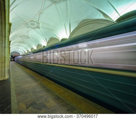 Moscow, Russia - 01 07 2015: A Moscow Metro Train Speeds Away From The Underground Station (with Mot