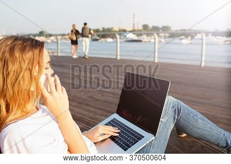 Blonde Casual Dressed Hipster Girl Having Cell Telephone Conversation During Freelance Work On Porta