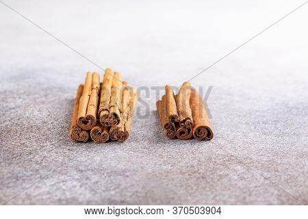 Ceylon Cinnamon  And Cassia Sticks On Concrete Background. Copy Space.