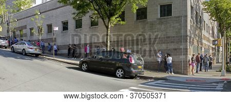 Bronx, New York/usa - May 26, 2020: People Stand On Line Outside Waiting To Get Tested At A Center F