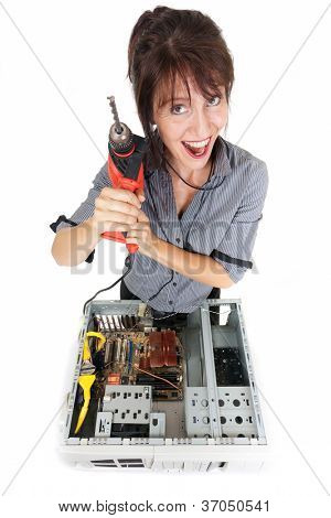 crazy business woman going repairing computer with drill