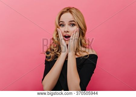 Amazing White Lady With Blonde Hair Expressing Surprised Emotions. Refined Fair-haired Female Model
