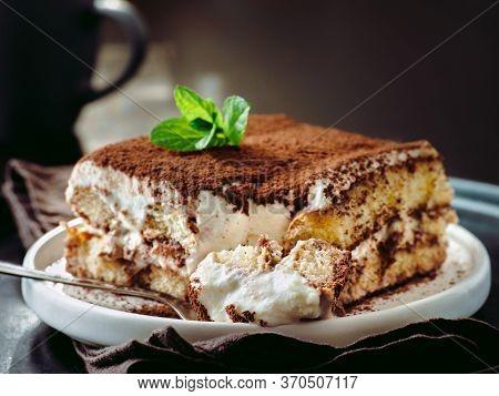Perfect Homemade Tiramisu Cake In Spoon. Tiramisu Portion On Plate Over Dark Tabletop Background. De