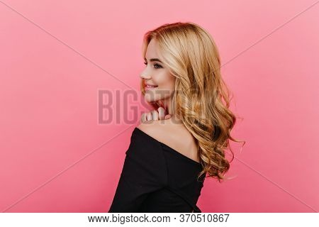 Wonderful Pale Girl With Elegant Curly Hairstyle Looking Away. Studio Shot From Back Of Pleased Fair