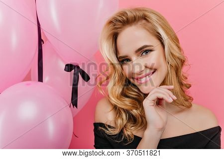 Close-up Portrait Of Blissful Fair-haired Girl With Sincere Smile Posing In Her Birthday. Blue-eyed