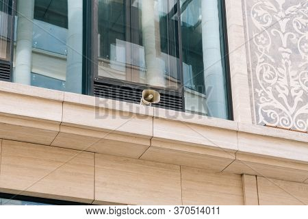 Loudspeaker On The Wall Of The Office Building. Business Center Alerts City Dwellers And Businessmen