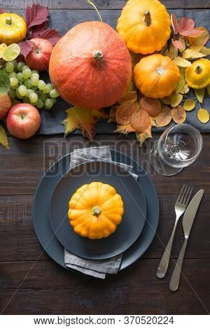 Fall Table Place Setting With Orange Dry Leaves And Pumpkins. Vertical Format. Centerpieces Thanksgi