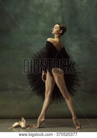 Confident. Graceful Classic Ballerina Dancing, Posing Isolated On Dark Studio Background. Elegance B