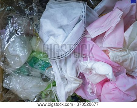 Used Sanitary Napkins, Surgical Face Mask, And Plastic In The Trash. Infectious Waste Management Con