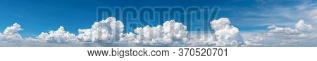 White Fluffy Clouds On Blue Sky. Soft Touch Feeling Like Cotton. White Puffy Clouds Cape With Space