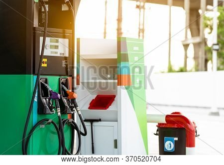 Petrol Pump Filling Fuel Nozzle In Gas Station. Fuel Dispenser Machine. Refuel Fill Up With Petrol G