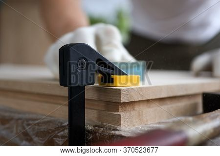 Male Carpenter Polishes Wooden Planks Fixed Vise. Manufacturing Various Joinery Structures And Produ