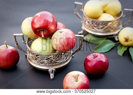 Fresh Organic Apples And Pears In Antique Silver Bowl On Table