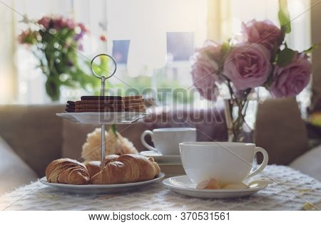 Traditional English Tea Time, Afternoon Tea Ceremony With Cuppa Tea, Croissants, Crackers And Biscui