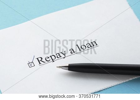 A Piece Of Paper With The Inscription Repay A Loan From To Do List With A Tick
