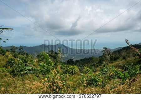A Dirt Road Among The Jungle And Mountains. Rural Dirt Road In The Tropical Forest In Thailand With