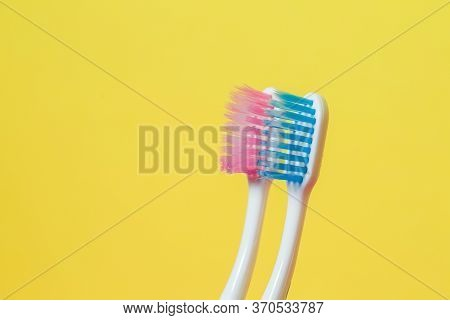 Two Toothbrushes Pink And Blue. Toothbrush Concept For A Couple, Living Together As The Beginning Of