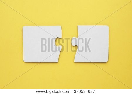 Two Empty Puzzles For Text On A Yellow Background