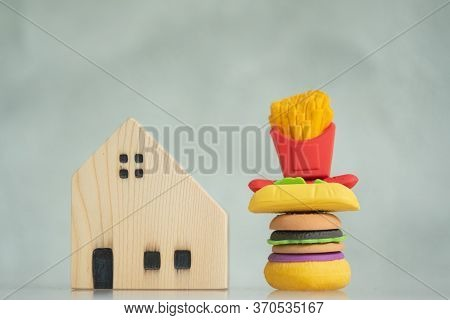 Miniature Toy Fast Food With Miniature Wooden House. Concept Of Fast Order Delivery To Home