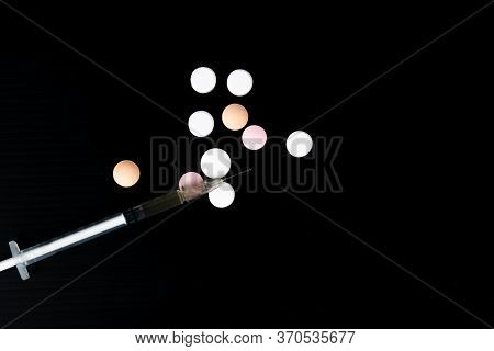 Top View Different Drugs - Powder And Pills And A Syringe On A Black Background. Stop Drug Addiction