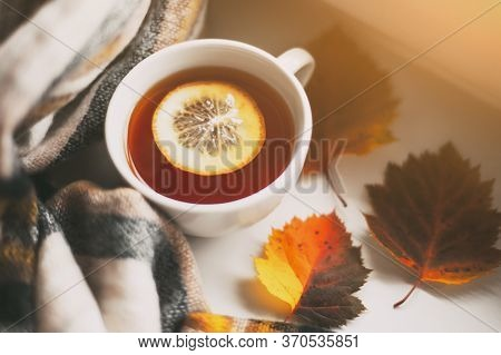 Autumn Cup Of Tea With Lemon, Yellow Autumn Leaves And Plaid