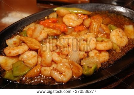 Sizzling Gambas Shrimp With Mixed Vegetables And Spices For Lunch Served In Sizzling Plate