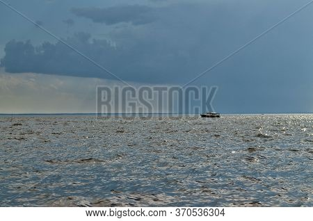 Quiet Expanse Of Water.calm Sea.a Boat Is Visible On The Horizon.