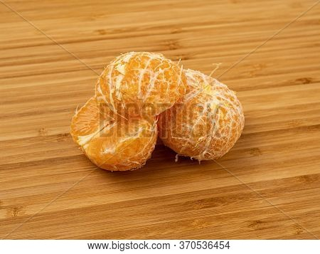 Mandarin On A Wooden Background. Wooden Plank. Harvest Of Fresh Tangerines. Ripe Fruit. Wood Texture