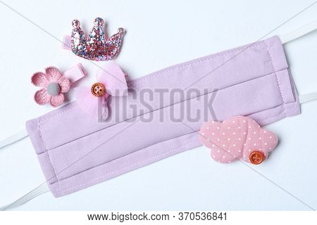Homemade Protective Mask And Adorable Girly Hair Clips On White Background, Flat Lay. Sewing For Chi