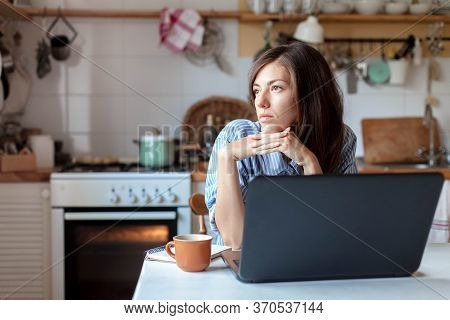 Working From Home Office. Upset Woman Using Laptop And Internet. Freelancer Workplace At Kitchen Tab